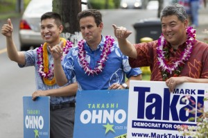 L-R: State House Rep. Takashi Ohno, Sen. Brian Schatz and Congressional candidate Mark Takai, all Democrats from Hawaii, do some last minute campaigning on Tuesday in Honolulu. (AP Photo/Marco Garcia)