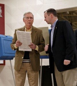 Senate Minority Leader Mitch McConnell (R-Ky.) (L) waits for his wife as they vote in Louisville Tuesday. (AP Photo/J. Scott Applewhite)