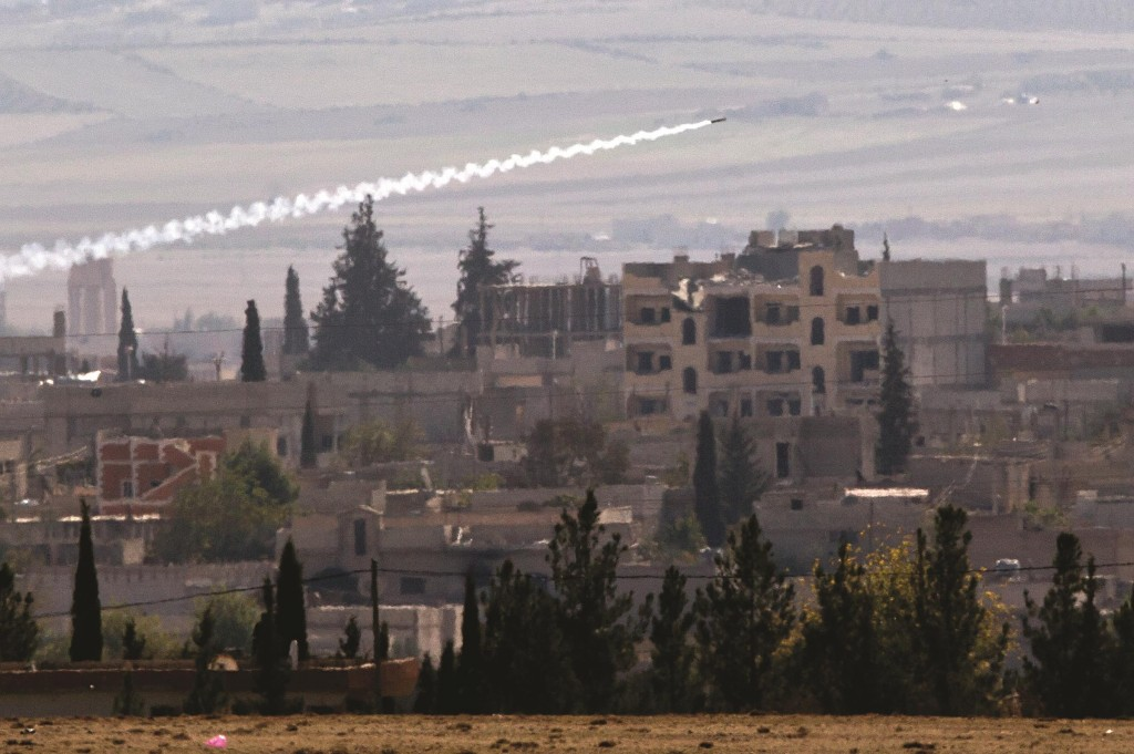 A missile is fired from Islamic State positions in Kobani, seen from a hilltop outside Suruc, on the Turkey-Syria border, Thursday. (AP Photo/Vadim Ghirda)