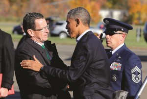 President Barack Obama is met by Connecticut Governor Dan Malloy after arriving in New Haven, Connecticut, on Sunday.  (REUTERS/Larry Downing)