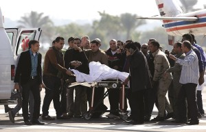 Former Egyptian President Hosni Mubarak waves to his supporters from his stretcher as he returns to Maadi military hospital in Cairo on Saturday. (REUTERS/Asmaa Waguih)