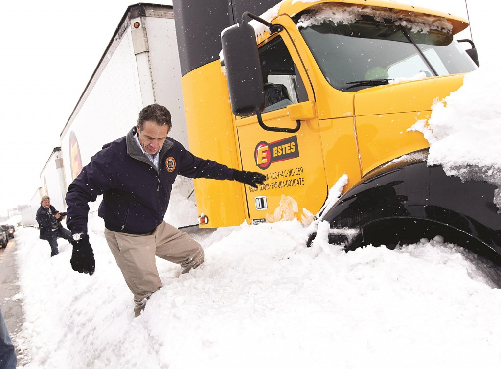 Governor Andrew Cuomo on Thursday climbs a snow bank after talking with one of more than 300 truckers stuck on the New York State Thruway, West Seneca, NY. Trucks and motorists were stranded after an autumn blizzard dumped almost a year's worth of snow. (Office of Governor Cuomo)