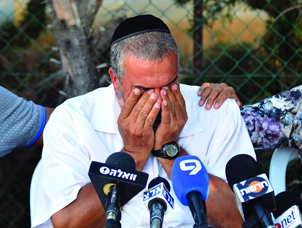 """The father of Netanel Arami, Hy""""d, a construction worker murdered, apparently, by Arab fellow-workers, in Petach Tikvah at a press conference on September 30. (Flash90)"""