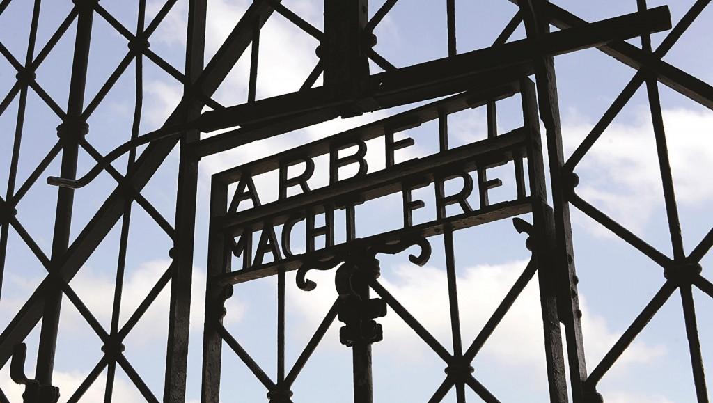 "In this file photo, the entrance gate of the former Nazi concentration camp in Dachau, near Munich, southern Germany, is pictured with the slogan whose translation is ""Work sets you free."" (AP Photo/Christof Stache, File)"