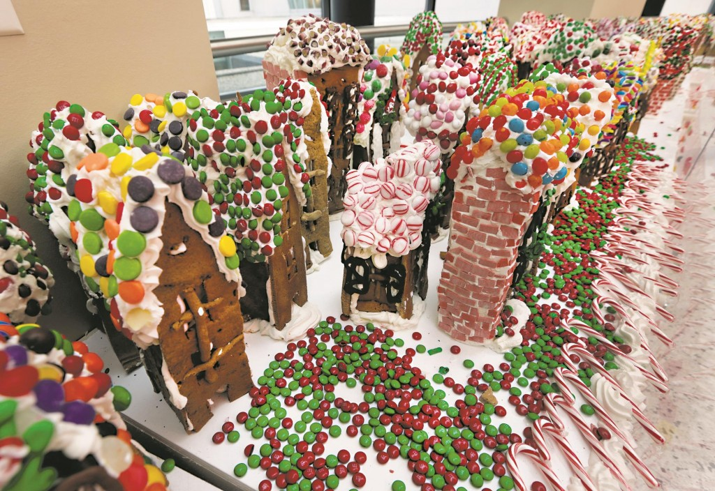 Some of the gingerbread-house creations by Chef Jon Lovitch are displayed Thursday in his GingerBread Lane, at the New York Hall of Science in Queens. (AP Photo/Richard Drew)