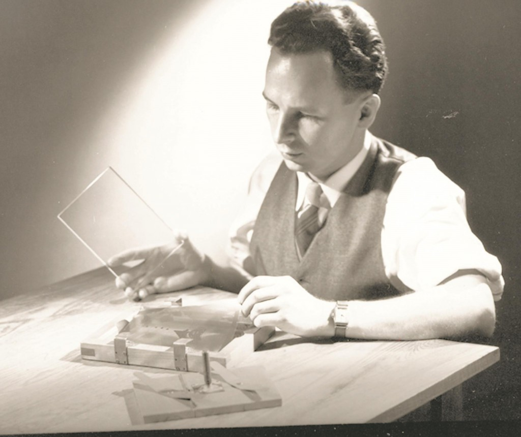 Dr. Don Stookey, inventor of CorningWare, in 1950 prepares to expose an image to ultraviolet light. (AP Photo/Corning)