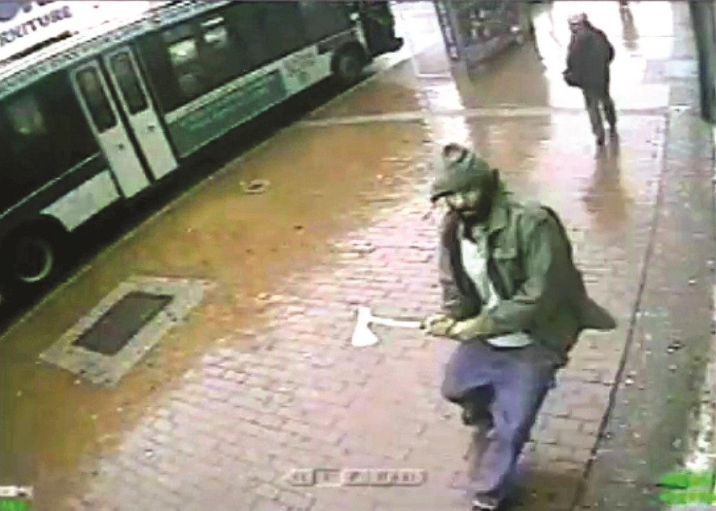 Zale Thompson on Oct. 23 approaches police officers in Queens with a hatchet. (AP Photo/NYPD)