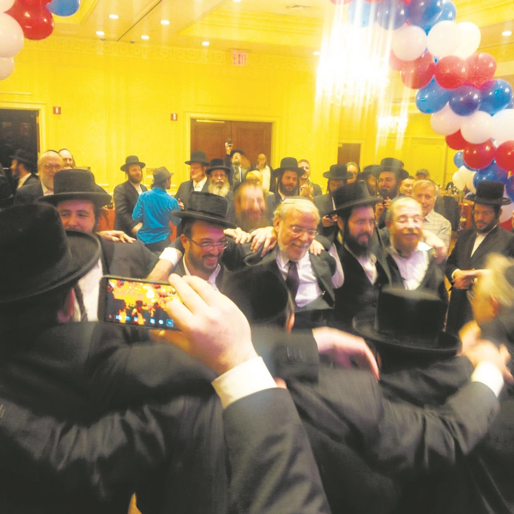 Assemblyman Dov Hikind (C) surrounded by jubilant supporters at his victory celebration Tuesday night.