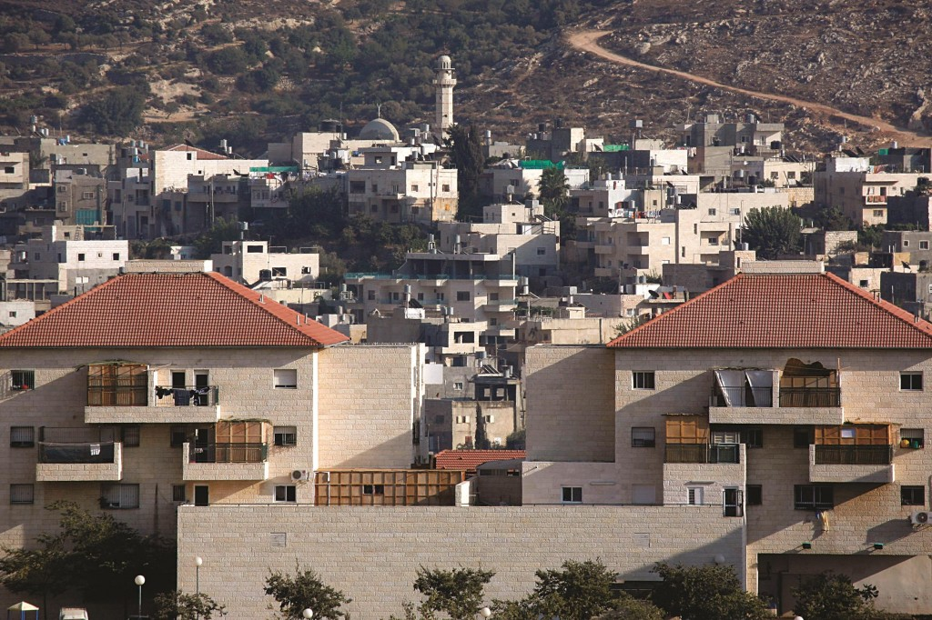 A view of Beitar Illit and the Palestinian village of Husan. (Nati Shohat/Flash90)