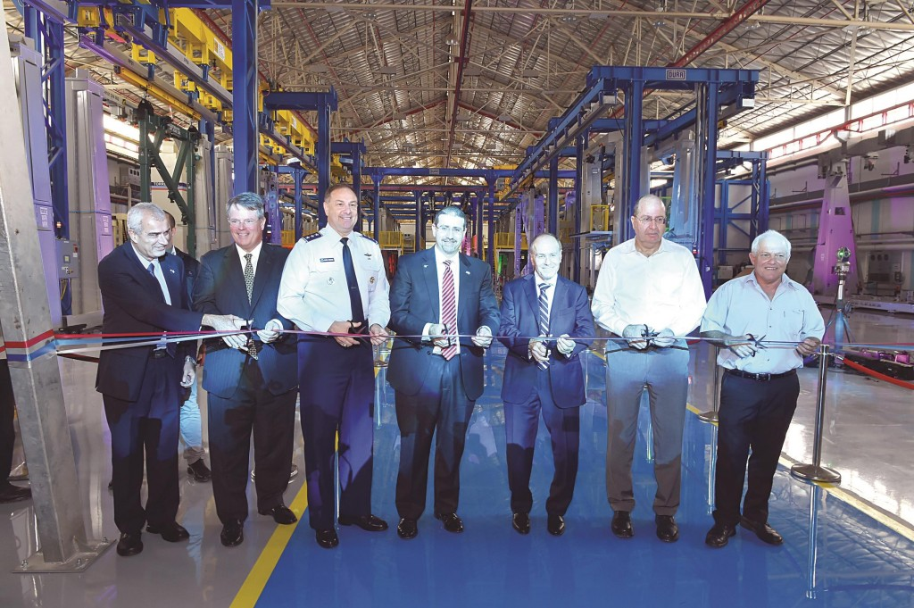 Israeli Minister of Defense Moshe Yaalon (second from right) seen at an inauguration ceremony at the Israel Aerospace Industries (IAI), near Tel Aviv, on its production line for the manufacture of wings for the F-35 fighter jet, Tuesday. (Ariel Hermoni/Ministry of Defense/Flash90)