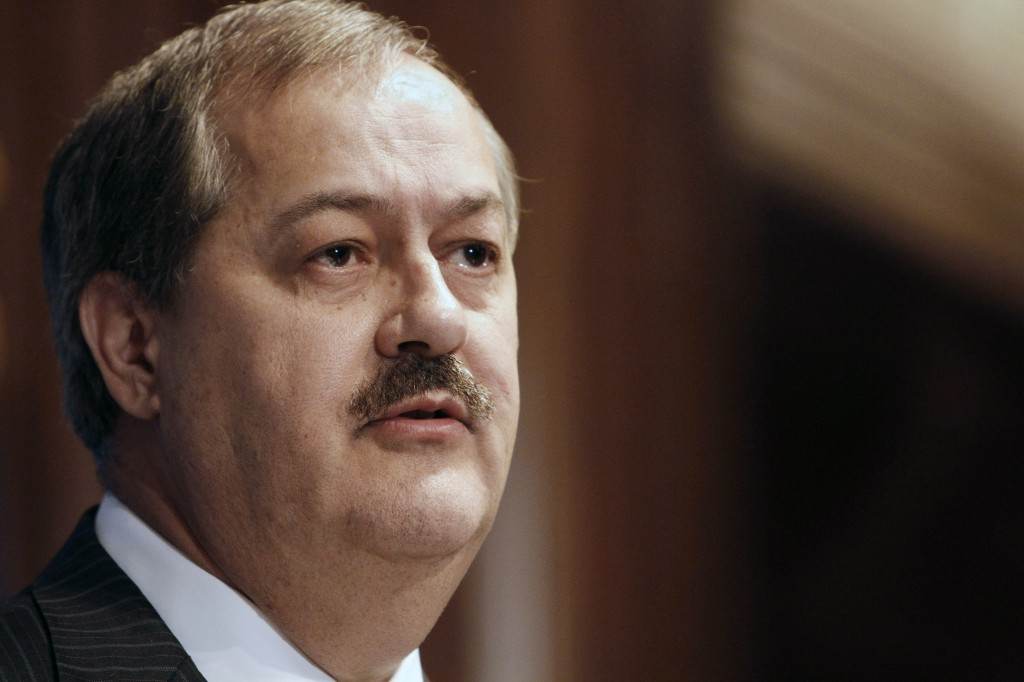 In this Thursday, July 22, 2010 file photo, former Massey Energy Company Chairman and CEO Don Blankenship speaks at the National Press Club in Washington. On Thursday, Nov. 20, 2014, Blankenship pleaded not guilty to conspiracy charges in a 2010 West Virginia mine explosion that killed 29 men. If convicted, Blankenship faces up to 31 years in prison. (AP Photo/Jacquelyn Martin, File)