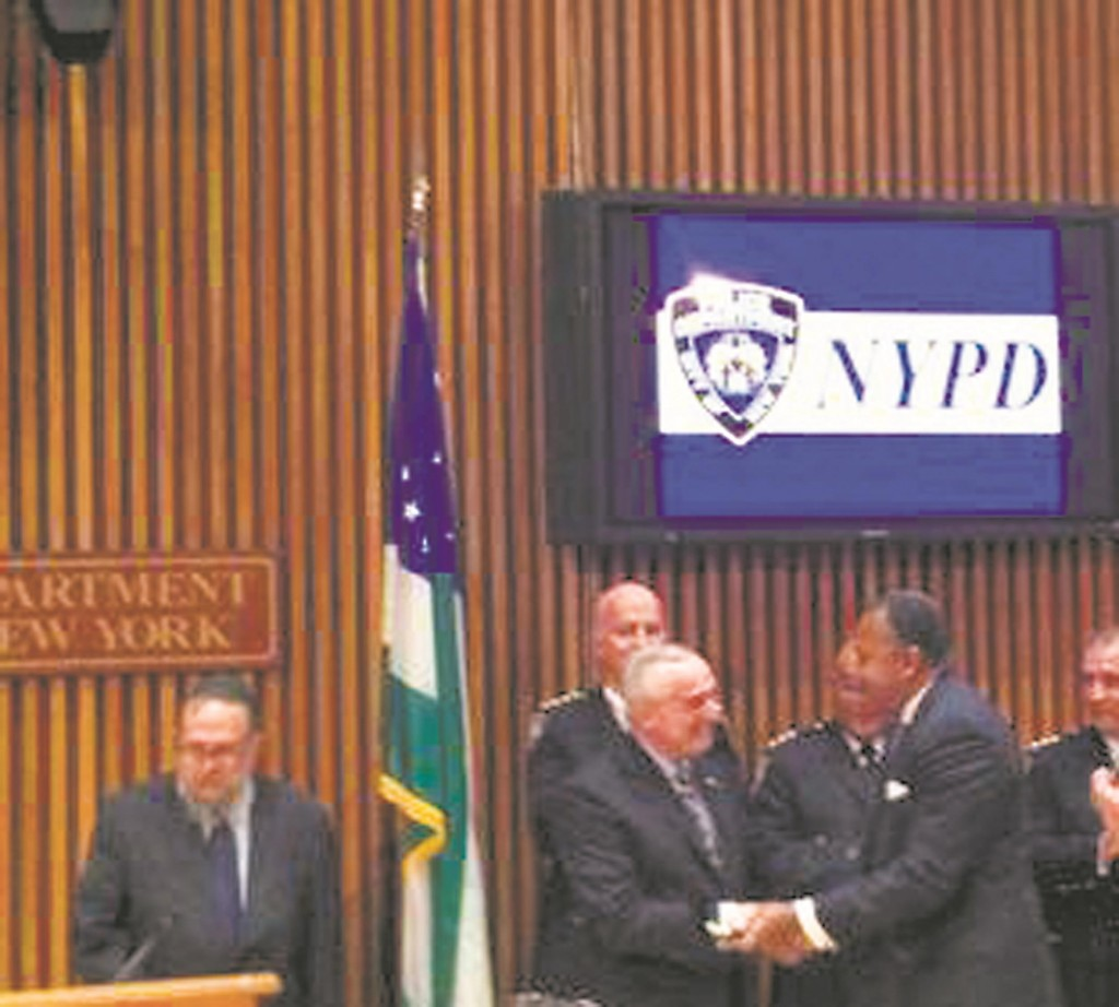 Incoming First Deputy Commissioner Ben Tucker is congragulated by Commissioner Bill Bratton on Wednesday shortly after he was sworn in. (NYPD)