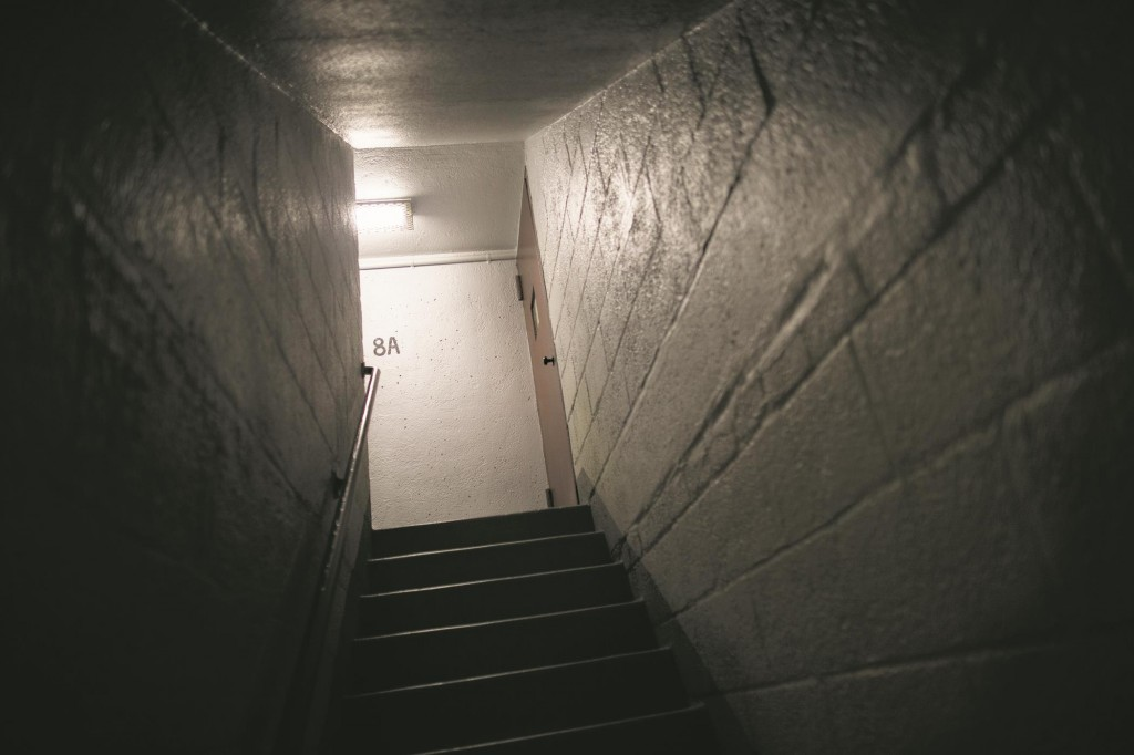 A new light illuminates the Brooklyn public housing stairwell where Akai Gurley was accidentally shot to death by a rookie officer on Saturday. (AP Photo/John Minchillo)