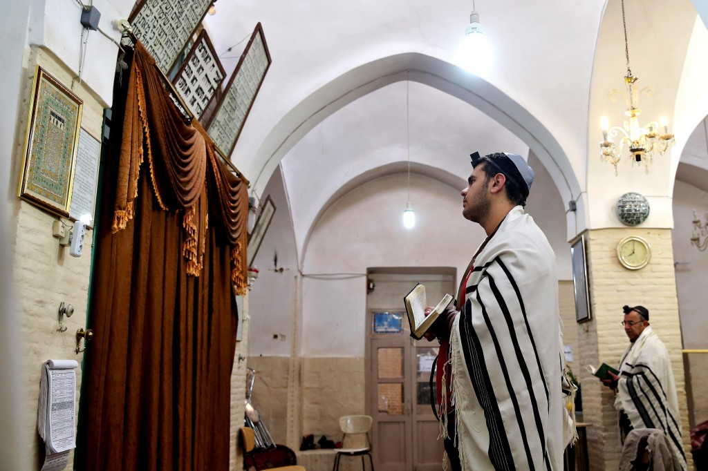 In this Friday, Nov. 21, 2014 photo, an Iranian Jew davens at the Molla Agha Baba Synagogue in the city of Yazd, 420 miles south of Tehran, the capital of Iran. (AP Photo/Ebrahim Noroozi)