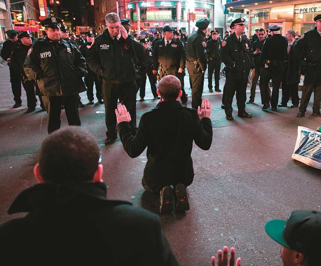 With hands up, demonstrators on Wednesday protest in Times Square. (AP Photo/Craig Ruttle)
