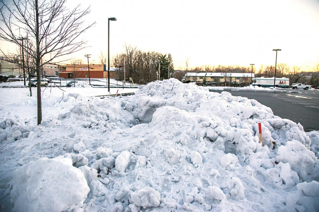 The snowbank (top) in which cousins Jason Rivera and Elijah Martinez (bottom, at a hospital news conference) built their snow fort at the corner of a parking lot in Newburg, N.Y. (AP Photo/Times Herald Record, Allyse Pullman)