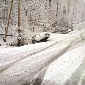 a car is stranded at the side of a road in Monroe. Between 3 and 4 inches of snow were reported in Rockland. (News Breakers)