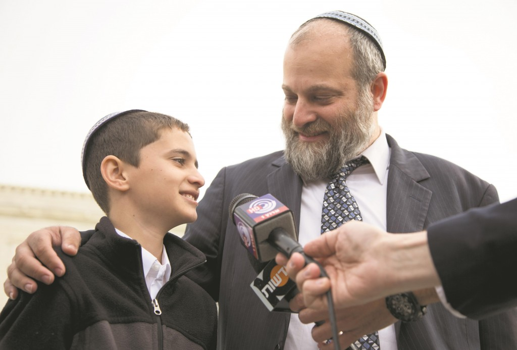 Menachem Zivotofsky (L) stands with his father, Ari Zivotofsky, to speak to media outside the Supreme Court in Washington, Monday, Nov. 3, 2014. (AP Photo/Carolyn Kaster)