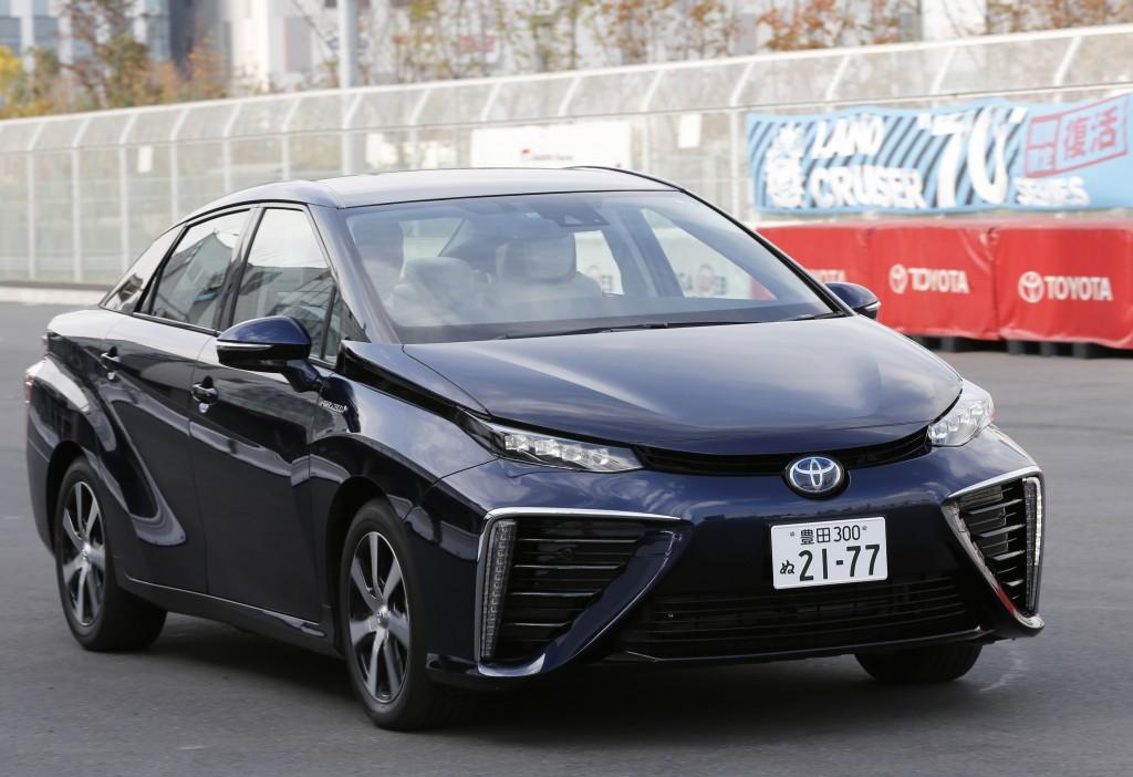 A Toyota Mirai drives at its showroom test course in Tokyo on Monday, Nov. 17, 2014. (AP Photo/Shizuo Kambayashi)