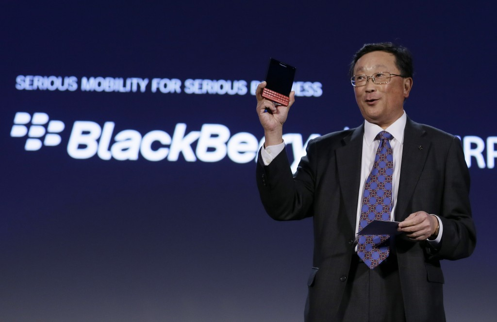 BlackBerry CEO John Chen provides a glimpse of a new red Passport model, available later this month, during the BlackBerry Enterprise Portfolio Launch event on Thursday, Nov. 13, 2014 in San Francisco. The red model will be available Nov. 28. (AP Photo/Eric Risberg)