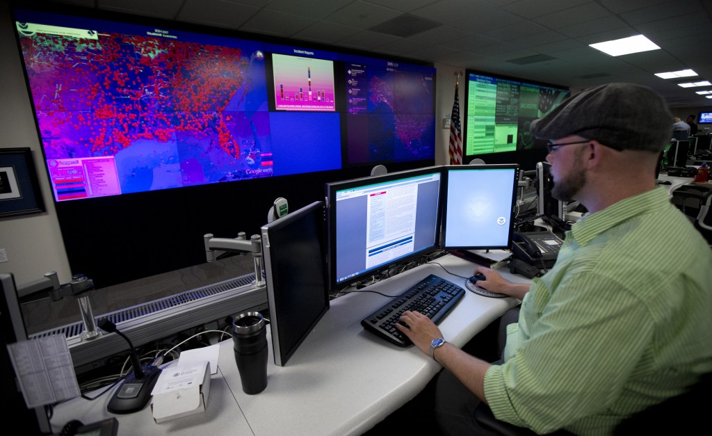 A specialist works at the National Cybersecurity and Communications Integration Center (NCCIC) in Arlington, Va., on Tuesday, Sept. 9, 2014. (AP Photo/Manuel Balce Ceneta)