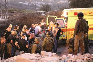 Israeli security and rescue personnel in the aftermath of the terrorist attack at Alon Shvut on Monday. (Gershon Elinson/Flash90)