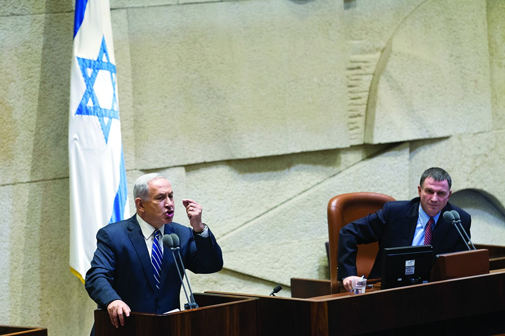 Israeli Prime Minister Binyamin Netanyahu answering critics in the Knesset. (Miriam Alster/FLASH90)