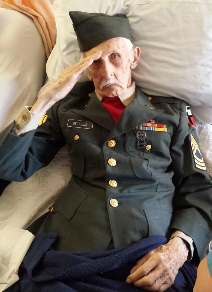 World War II veteran Justus Belfield, 98, saluting on Veterans Day Tuesday. He passed away the next day. (AP Photo/ Nancy McKiernan/Baptist Health Nursing and Rehabilitation Center)