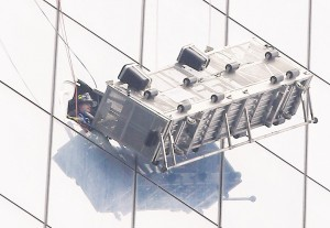 A partially collapsed scaffolding on Wednesday hangs from 1 World Trade Center with two workers stuck inside 69 stories above street level. (Getty images , AP Photo/Kathy Willens)