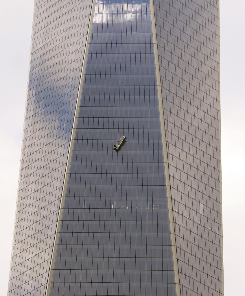 A partially collapsed scaffolding on Wednesday hangs from 1 World Trade Center with two workers stuck inside 69 stories above street level. (Getty Images)