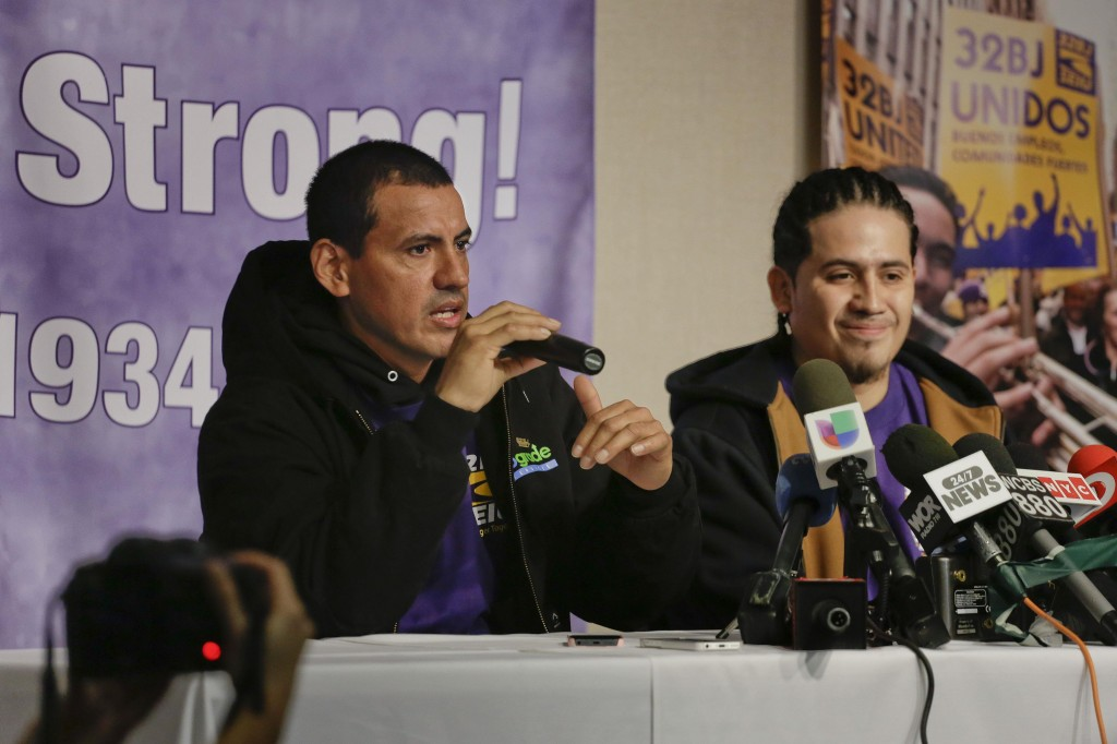 Juan Lizama (L) answers questions during a news conference as co-worker Juan Lopez looks on, Friday. (AP Photo/Julie Jacobson)