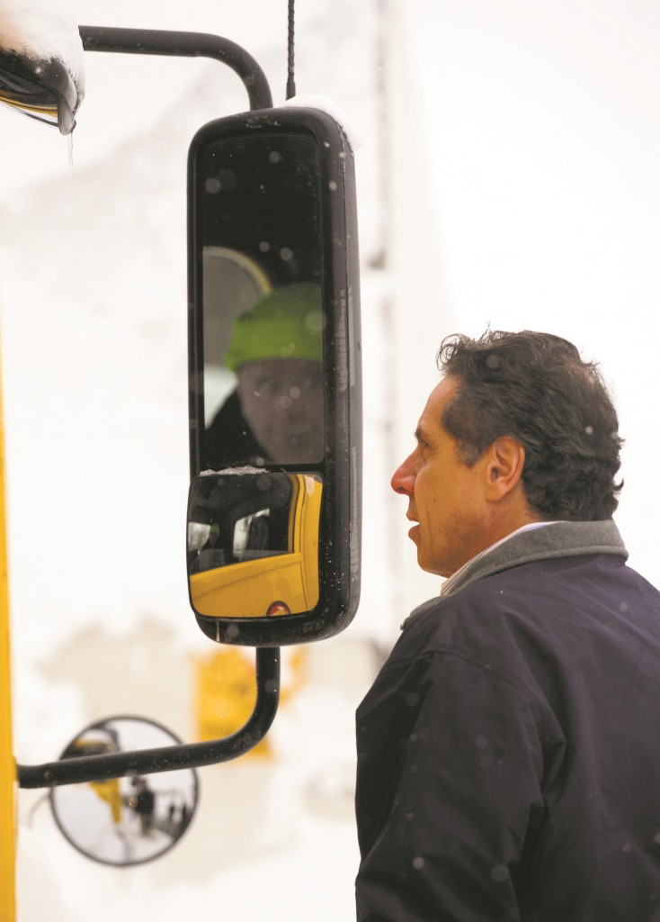 New York Gov. Andrew M. Cuomo listens to a truck driver stranded on the New York State Thruway in West Seneca, N.Y., Wednesday, Nov. 19.  (AP Photo/Gary Wiepert)