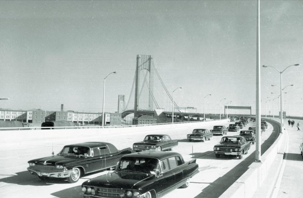 An official motorcade crosses the Verrazano-Narrows Bridge on the way to Staten Island for dedication ceremonies for the bridge in New York, Nov. 21, 1964.  (AP Photo)