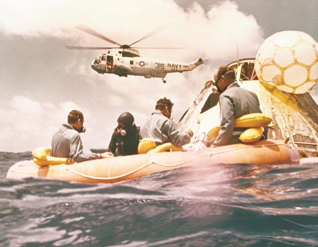 Sitting in the life raft, during the Apollo 12 Pacific recovery, are the three mission astronauts; Alan L. Bean, pilot of the Lunar Module (LM), Intrepid; Richard Gordon, pilot of the Command Module (CM), Yankee Clipper; and Spacecraft Commander Charles Conrad.