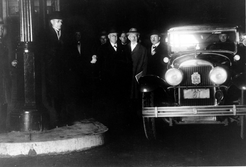 Tunnel Commission officials pose as they pay the first Holland Tunnel toll at midnight after the dedication ceremony in New York on Nov. 12, 1927. (AP Photo)