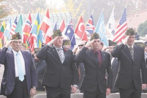 U.S. veterans who fought in foreign wars salute during a Veteran's Day Ceremony at Yongsan Garrison, the main U.S. military headquarters in Seoul, South Korea, Tuesday. (AP Photo/Susan Walsh)