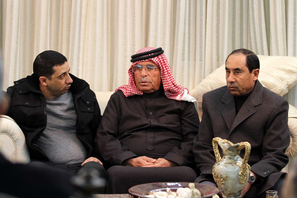 Safi Al-Kasaesbeh (C), father of the Jordanian pilot Muath, who was captured by Islamic State group after his plane came down near Raqqa in Syria on Wednesday, sits with other relatives as he appeals for ISIS to release his son, in Amman Thursday. (AP Photo/Raad Adayleh)