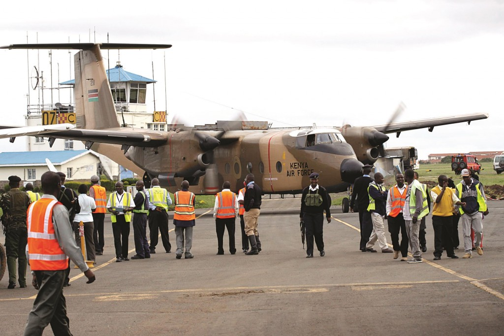 A Kenyan military aircraft carrying some of the bodies of those killed in the Mandera quarry attack, arrives at Wilson Airport in Nairobi, Kenya, Tuesday. (AP Photo/Khalil Senosi)