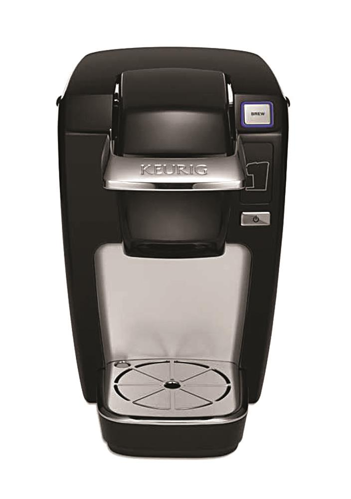 This undated product image from Keurig and released by the Consumer Product Safety Commission shows the Keurig Mini Plus coffee brewer. Keurig is recalling more than 7 million of the single-serve coffee brewing machines after reports that a number of them had spewed hot liquids and injured dozens of users, the company said Tuesday. (AP Photo/Keurig via the Consumer Product Safety Commission)