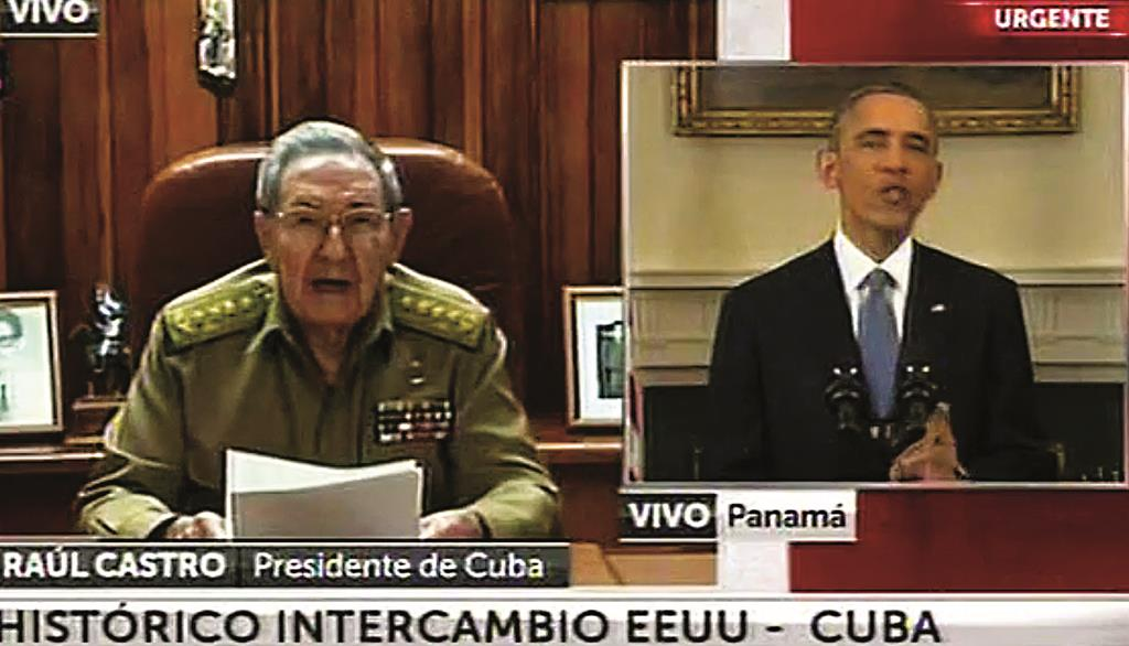 This screen shot taken from live video from the TN channel shows President Barack Obama, right, and Cuba's President Raul Castro addressing their nations at the same time, from Washington D.C. and Havana, on Wednesday.  (AP Photo)