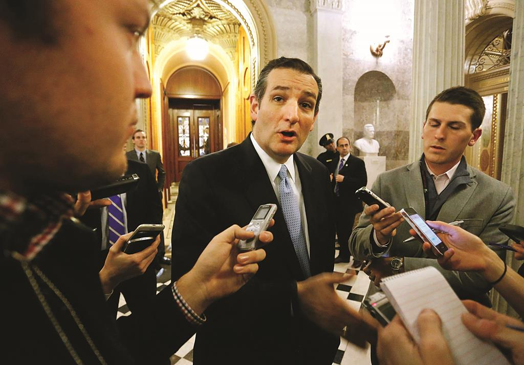 Senator Ted Cruz (R-TX) talks to reporters after the Senate passed a $1.1 trillion spending bill following a long series of votes, at the U.S. Capitol in Washington on December 13. (REUTERS/Jonathan Ernst)