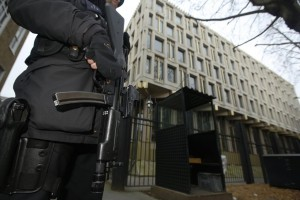A police officer patrols outside the U.S. embassy in London Tuesday. (REUTERS/Luke MacGregor)