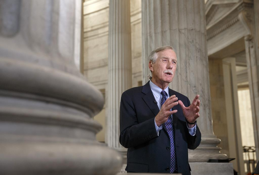 Senate Intelligence Committee member Sen. Angus King (I-Maine) defends the panel's planned release of a report on the CIA's harsh interrogation techniques, Tuesday, during a news show interview on Capitol Hill in Washington.  (AP Photo/J. Scott Applewhite)
