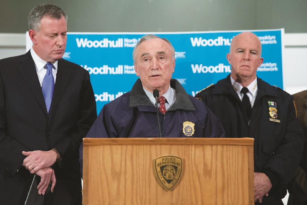 New York Police Department Commissioner Bill Bratton speaks alongside Mayor Bill de Blasio, (L), and NYPD's Chief of Department James O'Neill, (R), during a news conference at Woodhull Medical Center, Saturday, in New York.  (AP Photo/John Minchillo)