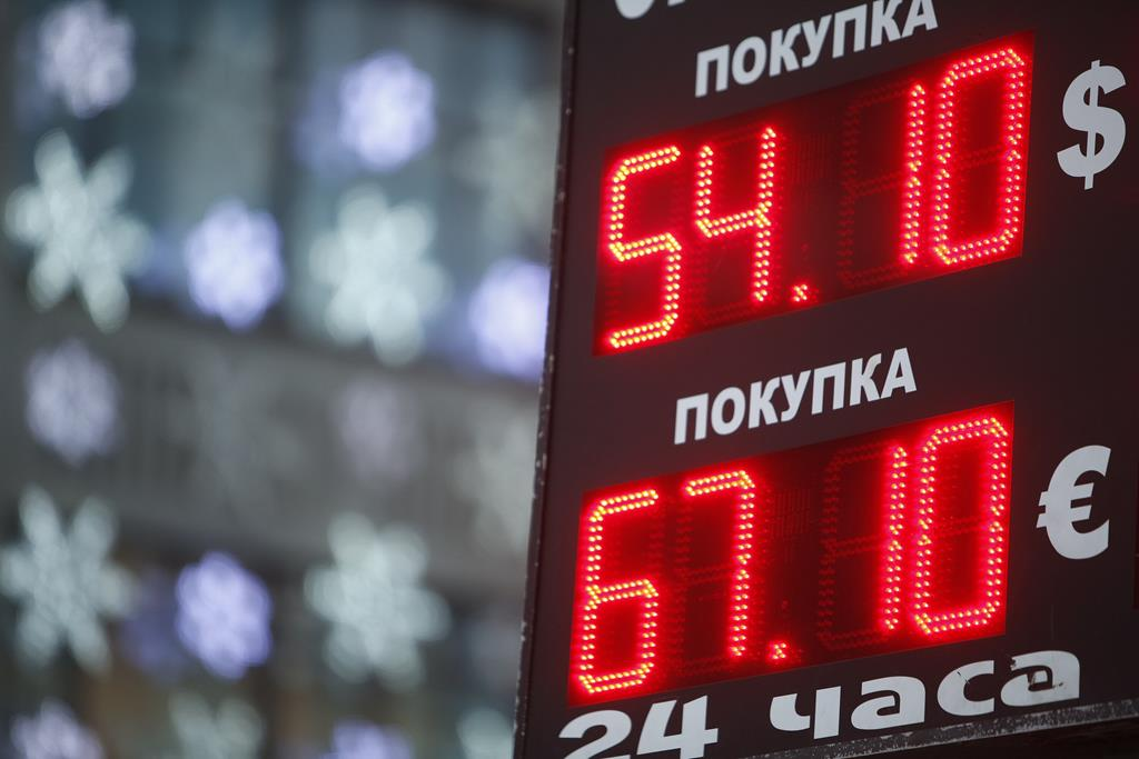 A board showing currency exchange rates on display in Moscow. (REUTERS/Sergei Karpukhin)