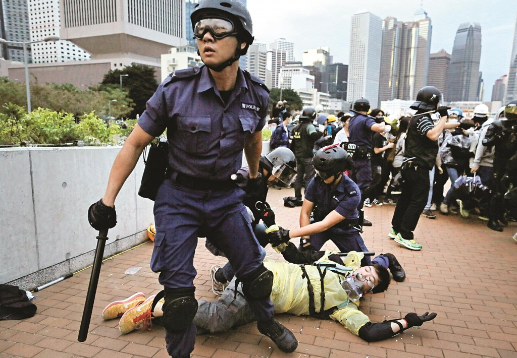 A protester is arrested by police officers outside government headquarters in Hong Kong, Monday. (AP Photo/Vincent Yu)
