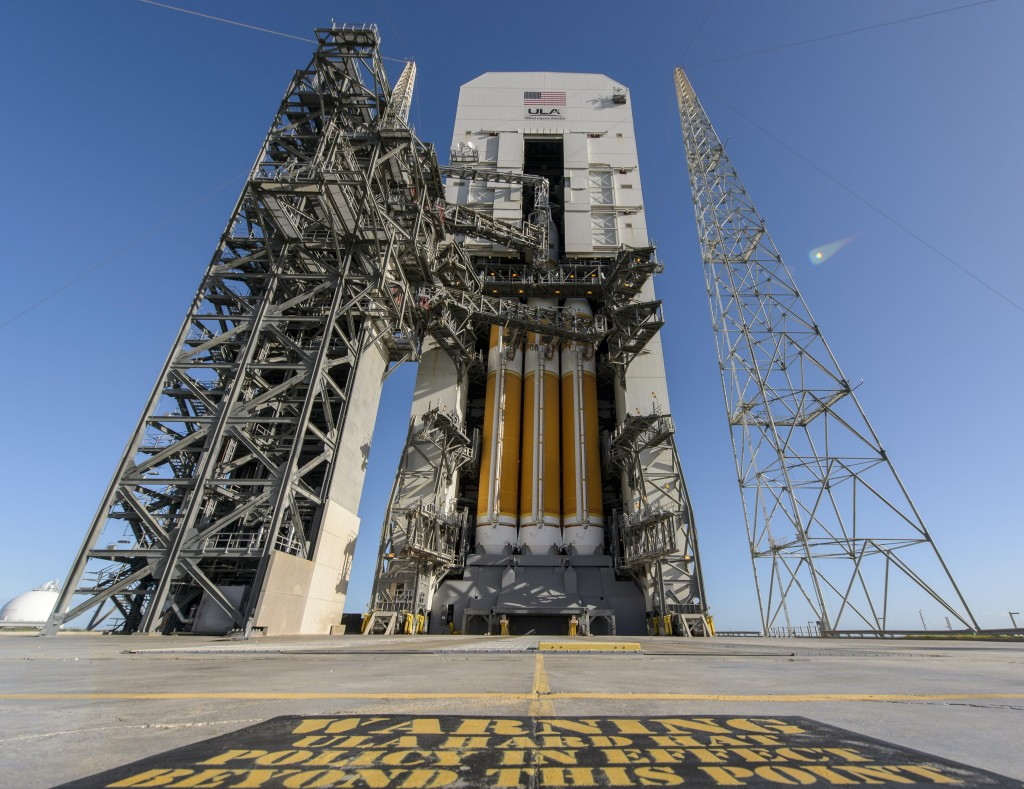 In a photo provided by NASA, the Orion space capsule is seen atop a Delta IV rocket ready for a test launch at Cape Canaveral Air Force Station, Wednesday, in Cape Canaveral, Fla.  (AP Photo/NASA, Bill Ingalls)