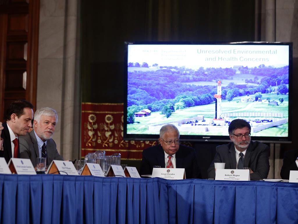 New York State Department of Environmental Conservation Commissioner Joseph Martens (2nd L) speaks about hydraulic fracturing during a cabinet meeting at the Capitol on Wednesday, in Albany, NY. (APPhoto/Mike Groll)
