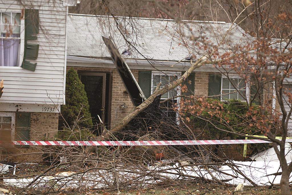 The wreckage of a small plane that crashed into a house in Gaithersburg, Md., Monday.  (AP Photo/Jose Luis Magana)
