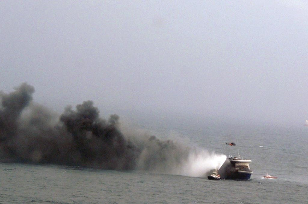 In this image provided by the Italian Navy, smoke billows from the Italian-flagged Norman Atlantic after it caught fire in the Adriatic Sea, Sunday. (AP Photo/Italian Navy)